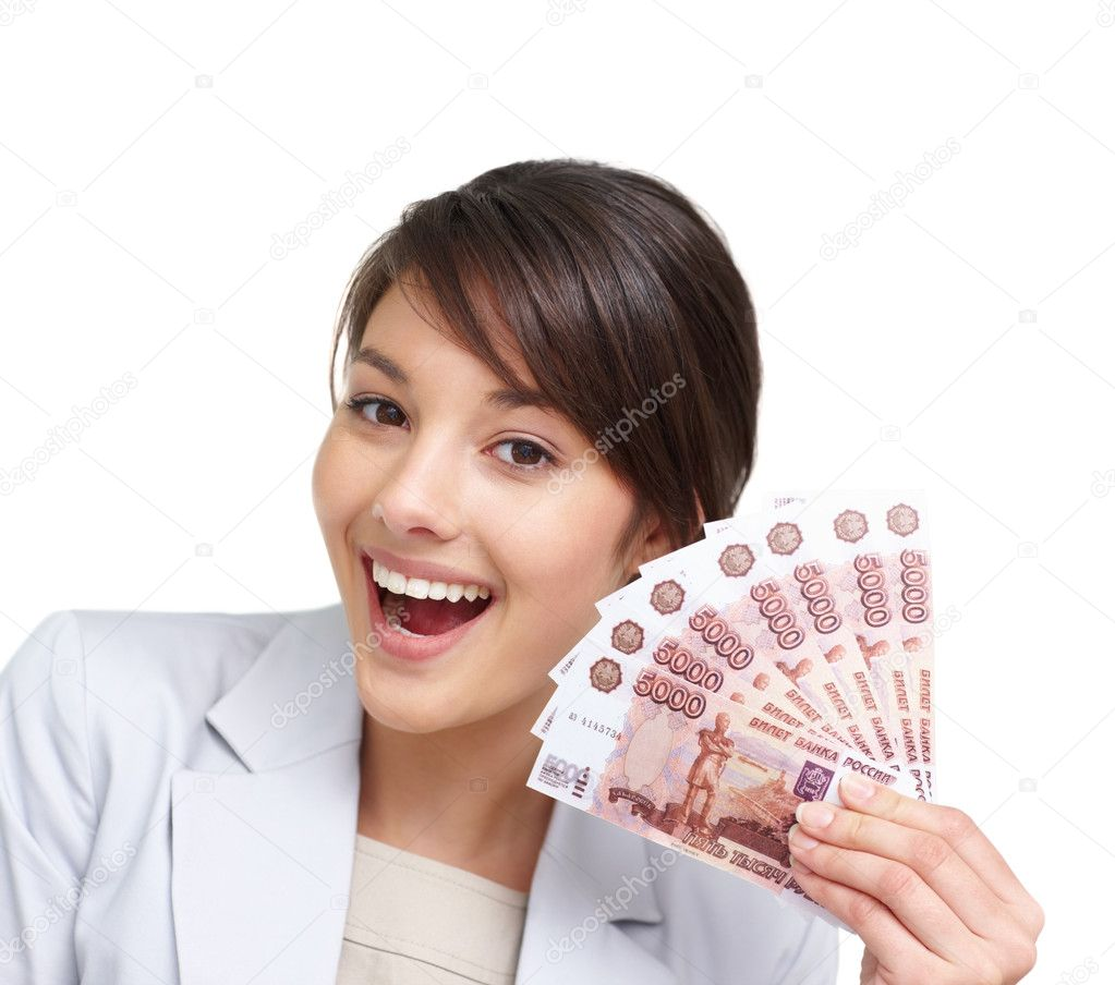 Portrait of a happy young female holding a fan of currency notes over white  Stock Photo #3408566