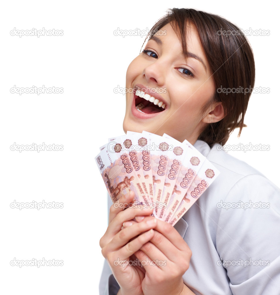 Portrait of a beautiful young woman holding a fan of currency notes over white — Stock Photo #3408584