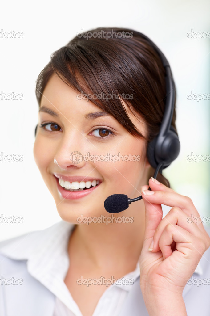 Closeup of a lovely young lady speaking over headset , call centre employee — Stock Photo #3409268