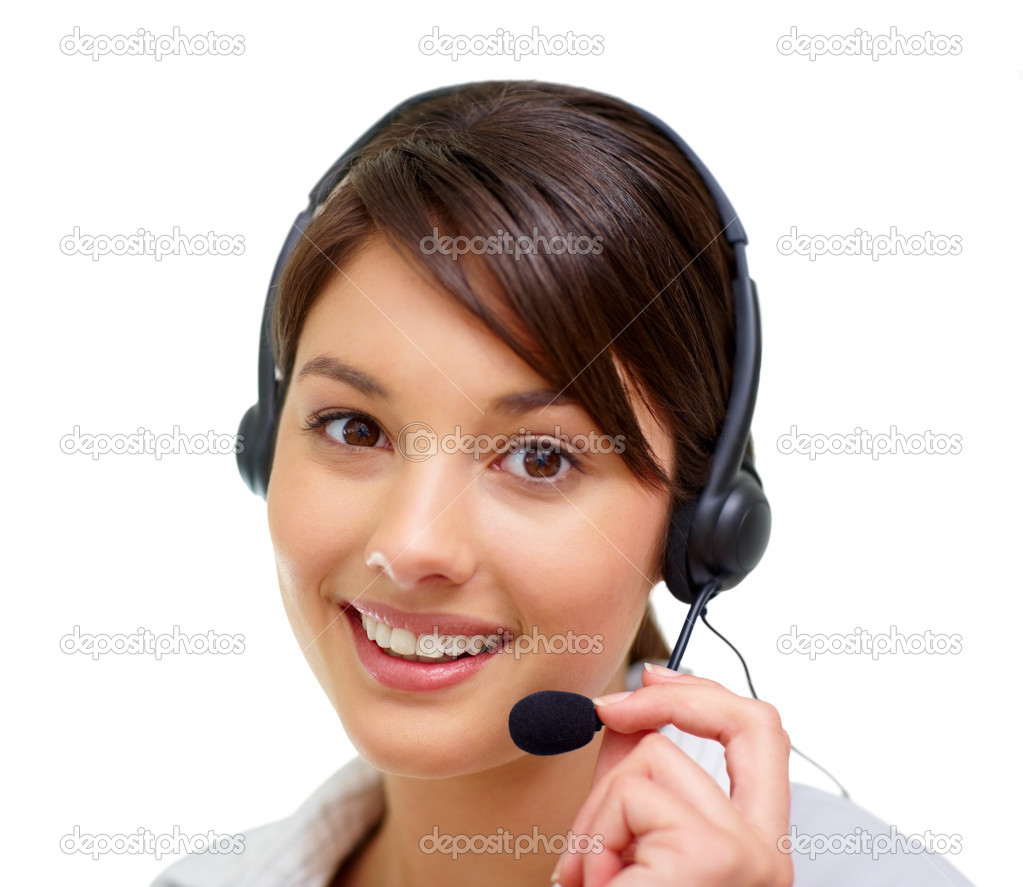 Closeup of a lovely female call centre employee speaking over a headset , white background — Stock Photo #3409280