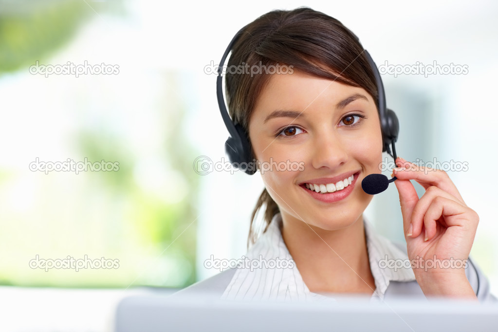 Successful female call centre employee speaking over the headset  Stok fotoraf #3409296