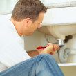 Royalty-Free Stock Photo: Plumber fixing a sink