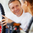 Royalty-Free Stock Photo: Man repairing a bicycle tyre with wife