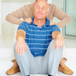 Royalty-Free Stock Photo: Senior man receiving shoulder massage from his wife at home