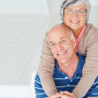 Royalty-Free Stock Photo: Romantic senior woman embracing her happy husband from behind