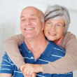 Royalty-Free Stock Photo: Romantic old woman embracing her happy husband from behind