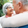 Royalty-Free Stock Photo: A happy loving senior couple embracing each other outdoors