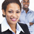 Closeup of a smiling young African American business woman - Stock Photo