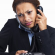 Royalty-Free Stock Photo: Busy business woman attending two calls at the same time