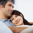 Closeup portrait of an affectionate couple sitting together rela - Foto Stock