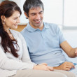 Happy mature couple using a laptop at home - Stock Photo