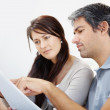 Closeup of mature couple planning their expenses - Stock Photo