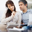 Royalty-Free Stock Photo: Portrait of a mature couple planning their financial budget