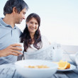 Happy mature couple having healthy breakfast in morning - Stock Photo