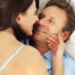 Royalty-Free Stock Photo: Closeup of a happy couple having a seductive moment in bed