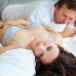 Royalty-Free Stock Photo: Woman having problems in bed with husband