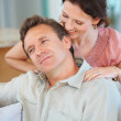 Royalty-Free Stock Photo: Mature woman giving a shoulder massage to a handsome man
