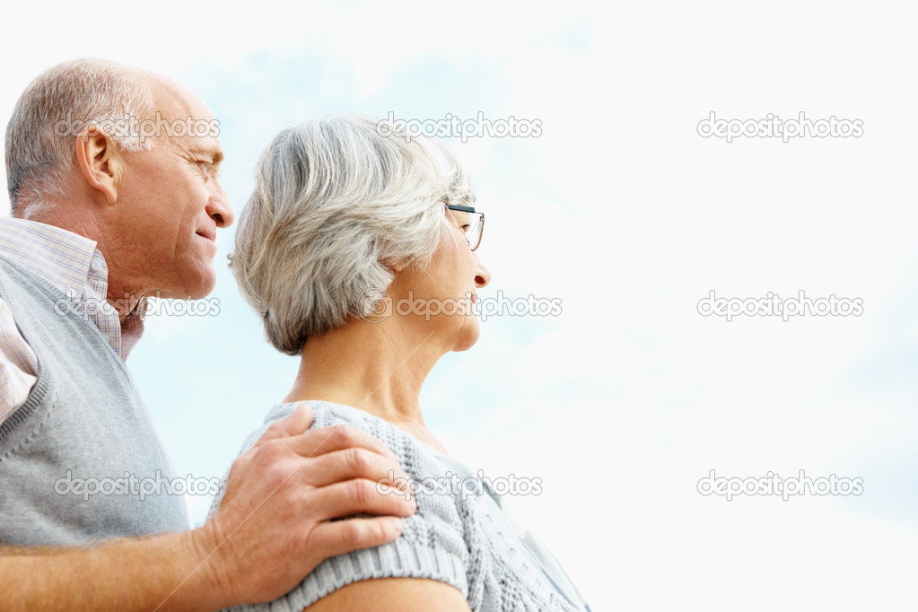 Side view of a loving senior man and woman with copy space outdoors — Stock Photo #3457550