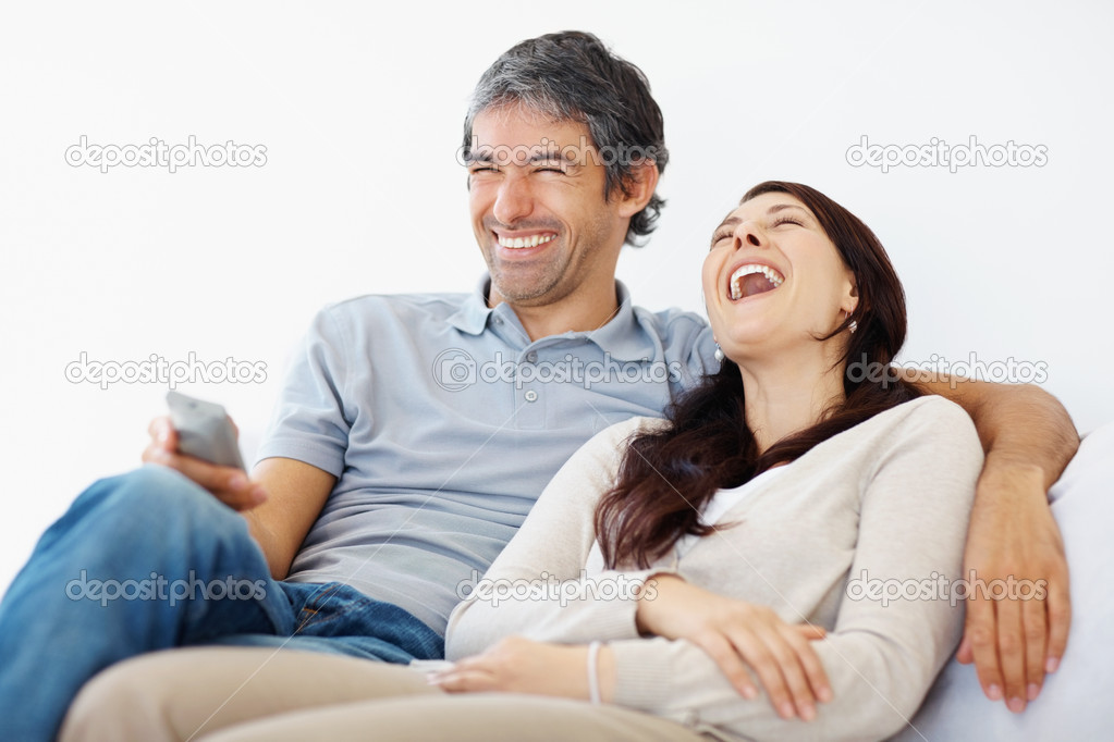 Portrait of a happy couple having fun together watching funny movie over white background - Copyspace — Stock Photo #3459232