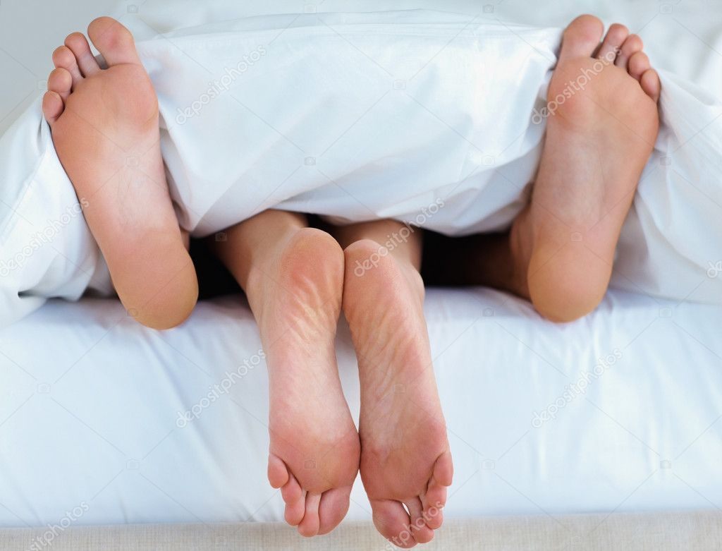 Closeup of a feet of couple having sex in bed — Stock Photo #3459574