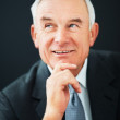 Royalty-Free Stock Photo: Senior business man in happy thought