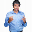 Royalty-Free Stock Photo: Portrait of superstitious male entrepreneur with fingers crossed