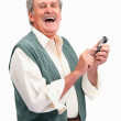 Royalty-Free Stock Photo: Smiling older man sending a text message on mobile phone