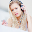 Royalty-Free Stock Photo: Attractive female listening to music over headphones