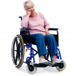 Retired senior woman sitting on a wheel chair - Stock Photo