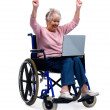 Royalty-Free Stock Photo: Achievement - Excited senior woman using laptop