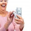Royalty-Free Stock Photo: Excited senior woman holding America dollars on white