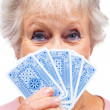 Royalty-Free Stock Photo: Old female holding playing cards
