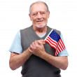 Royalty-Free Stock Photo: Old man holding a flag of America on white