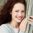 Portrait of pretty young lady smiling - Stock Photo