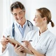 Successful medical staff making notes together - Stock Photo