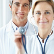 Royalty-Free Stock Photo: Handsome successful male doctor with a nurse