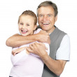 Royalty-Free Stock Photo: Cute small girl having fun with her grandfather