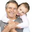 Royalty-Free Stock Photo: Cute little girl playing with her grandfather