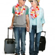 Elderly couple on holiday on white background - Stockfoto