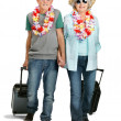 Sweet senior couple on holiday on white background - Stockfoto