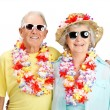 Happy old couple tourist wearing garland - Stock Photo