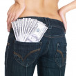 American currency in back pocket of female jeans - Foto Stock