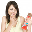 Royalty-Free Stock Photo: Cute young female getting tempted to eat the chocolate