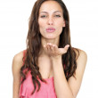 Elegant young female blowing you a kiss on white - Foto Stock