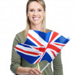Royalty-Free Stock Photo: Smiling female with Great Britain flag against white