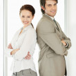 Royalty-Free Stock Photo: Smiling business standing confidently back to back
