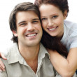 Cute young couple smiling together against white - Stock Photo