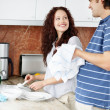 Royalty-Free Stock Photo: Cute couple doing their household chores with a smile