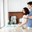 Royalty-Free Stock Photo: Couple doing the dishes together at home