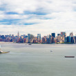 Aerial view of Statue of Liberty and New York Skyline - Stock Photo